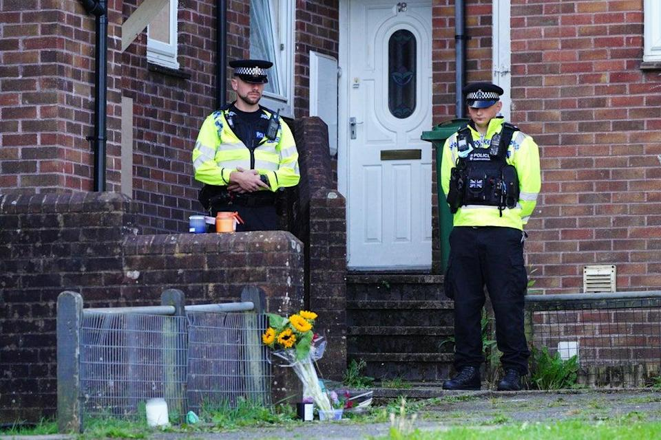 Floral tributes left outside the scene of the first shooting in Biddick Drive, Keyham (PA) (PA Wire)