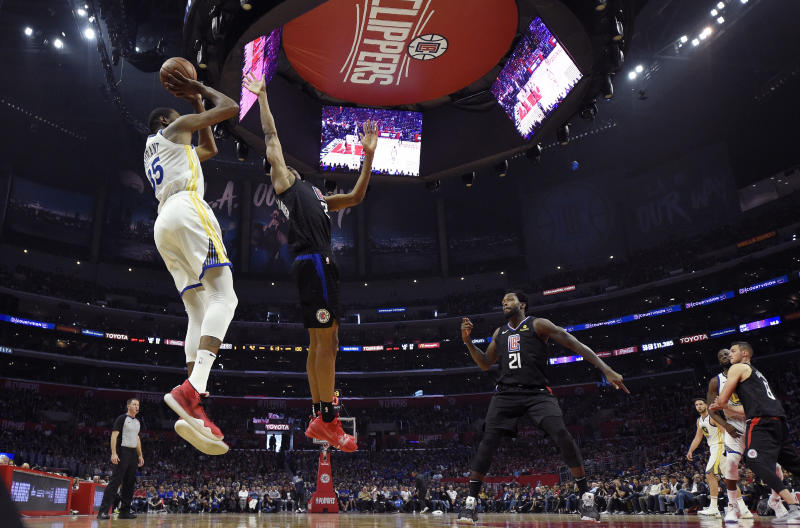 Golden State Warriors forward Kevin Durant, left, shoots as Los Angeles Clippers guard Shai Gilgeous-Alexander, second from left, defends during the second half in Game 4 of a first-round NBA basketball playoff series Sunday, April 21, 2019, in Los Angeles. The Warriors won 113-105. (AP Photo/Mark J. Terrill)