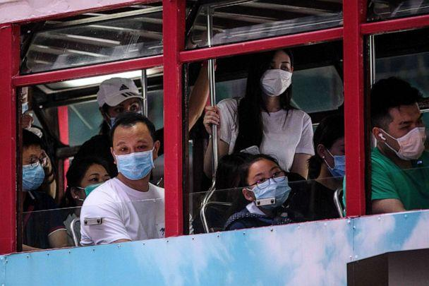 PHOTO: Commuters wear face masks as they travel on the top deck of a tram in Hong Kong on July 10, 2020, as the city experiences new local outbreaks of COVID-19. (Anthony Wallace/AFP via Getty Images)