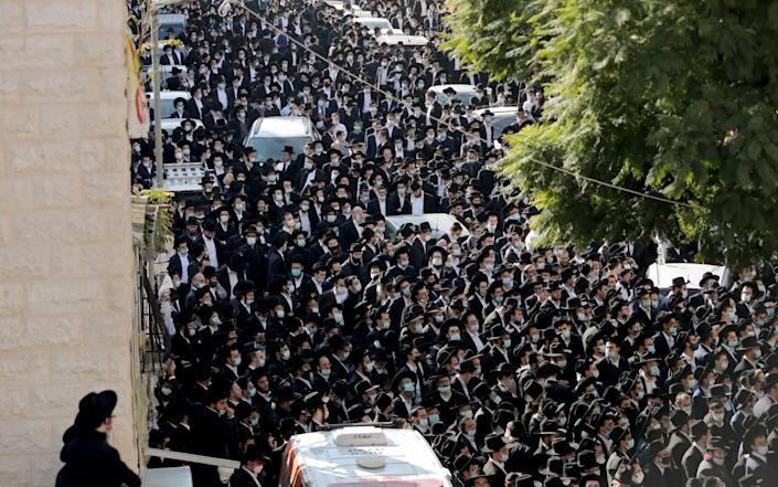 Ultra Orthodox Jews attend a mass funeral for Rabbi Aharon David Hadash, the spiritual leader of Jerusalem's Mir Yeshiva, one of the largest Jewish seminary in Israel, amid the coronavirus restrictions in Jerusalem - Reuters