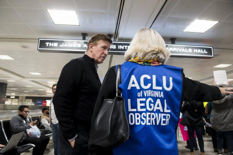 An ACLU legal observer with Rep. Don Beyer, D-Va., during the protest against the administration's travel ban at Dulles International Airport in Virginia on Jan. 29. (Photo: Bill Clark/CQ Roll Call)
