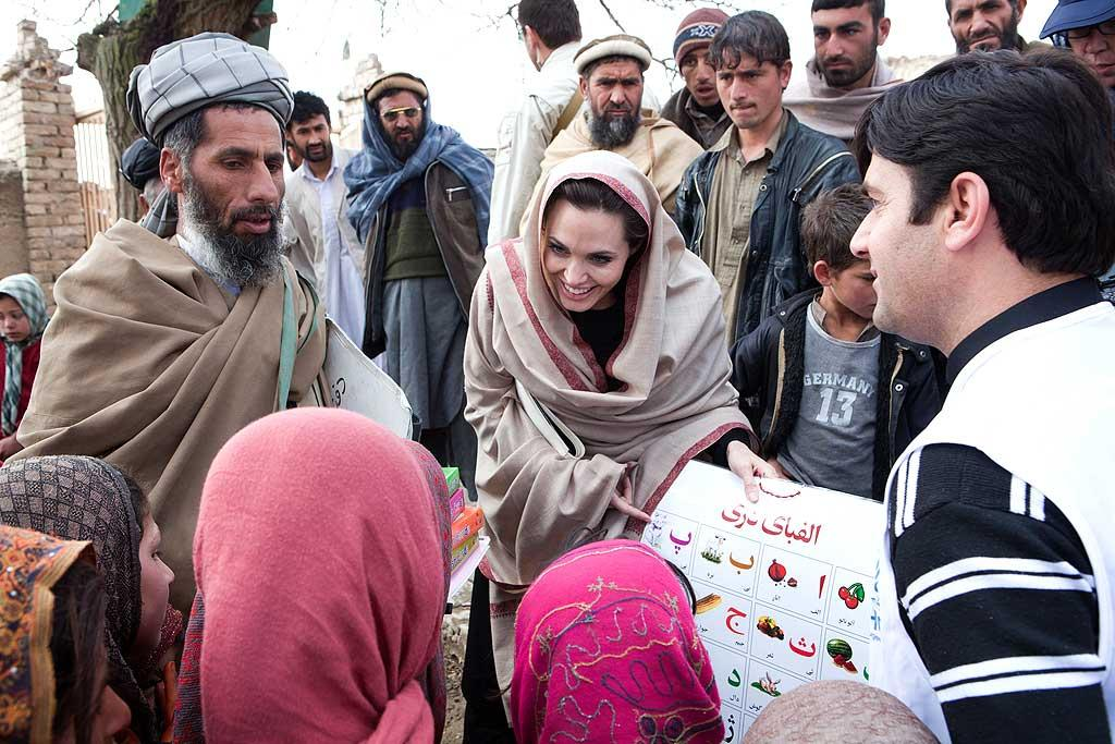 "UNHCR Goodwill Ambassador Angelina Jolie made a surprise trip to Afghanistan to meet with refugees, where the star delivered educational materials, and urged that more action be taken for the reintegration of Afghan exiles into their society. Jolie said in a statement, ""The focus needs to be put now on reintegration and that means not just putting up shelter but making sure there is water, job opportunities, a school for the children and medical clinics."" Jason Tanner/UNHCR/<a href=""http://www.gettyimages.com/"" target=""new"">GettyImages.com</a>"