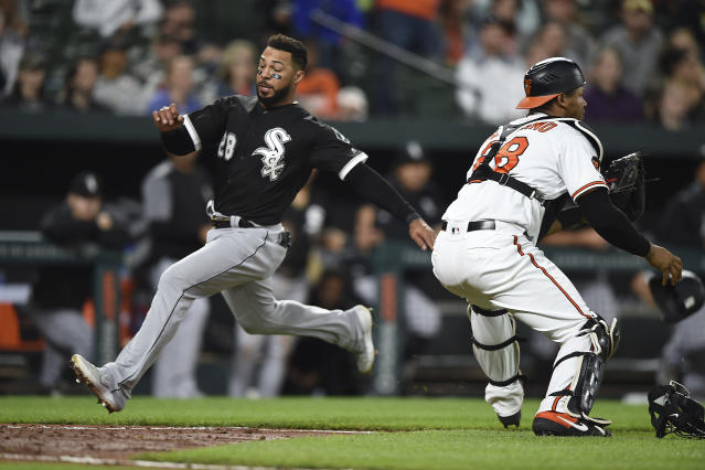 Chicago White Sox's Leury Garcia runs home to score as Baltimore Orioles catcher Pedro Severino awaits the throw on a single by Jose Abreu in the fourth inning of a baseball game, Monday, April 22, 2019, in Baltimore. (AP Photo/Gail Burton)