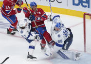 Montreal Canadiens' Brendan Gallagher (11) gets caught between Tampa Bay Lightning goaltender Andrei Vasilevskiy and Lightning's Anthony Cirelli during the third period of Game 3 of the NHL hockey Stanley Cup Final, Friday, July 2, 2021, in Montreal. (Paul Chiasson/The Canadian Press via AP)