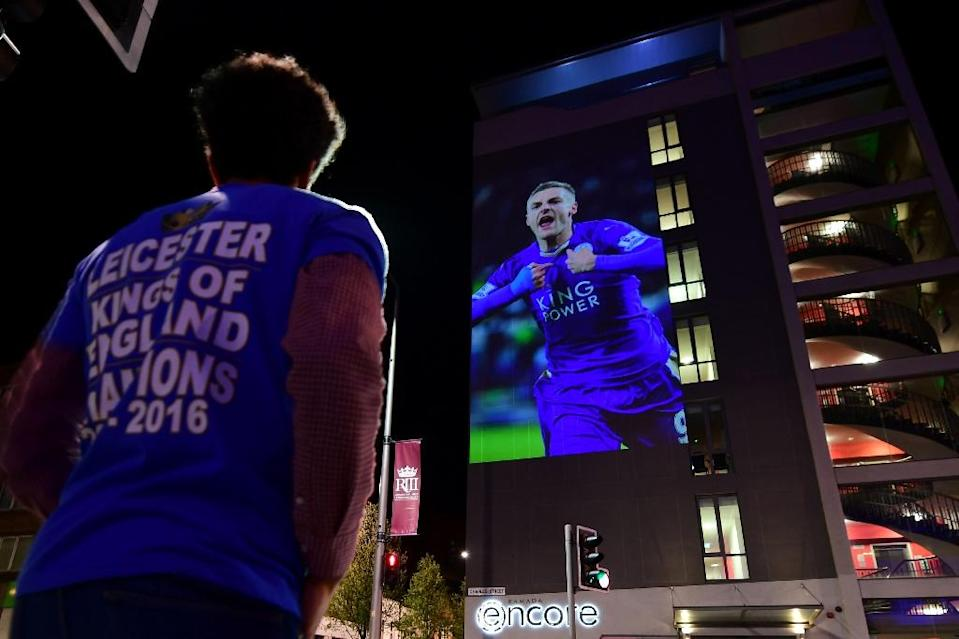 A Leicester City football fan celebrates the team's unlikely victory in the 2016 Premier League title race (AFP Photo/LEON NEAL)
