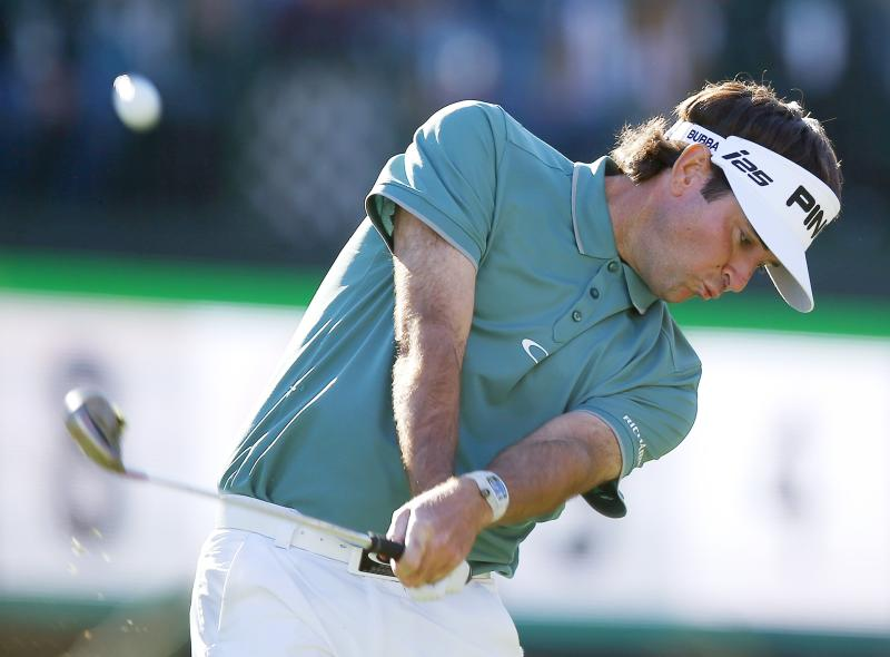 Bubba Watson hits his tee shot at the 16th hole during the third round of the Phoenix Open golf tournament Saturday, Feb. 1, 2014, in Scottsdale, Ariz. (AP Photo/Ross D. Franklin)