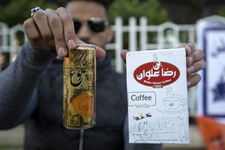 Iraqi protesters have rallied to show support for local products and to encourage the boycott of imported Iranian goods (AFP Photo/Hussein FALEH)