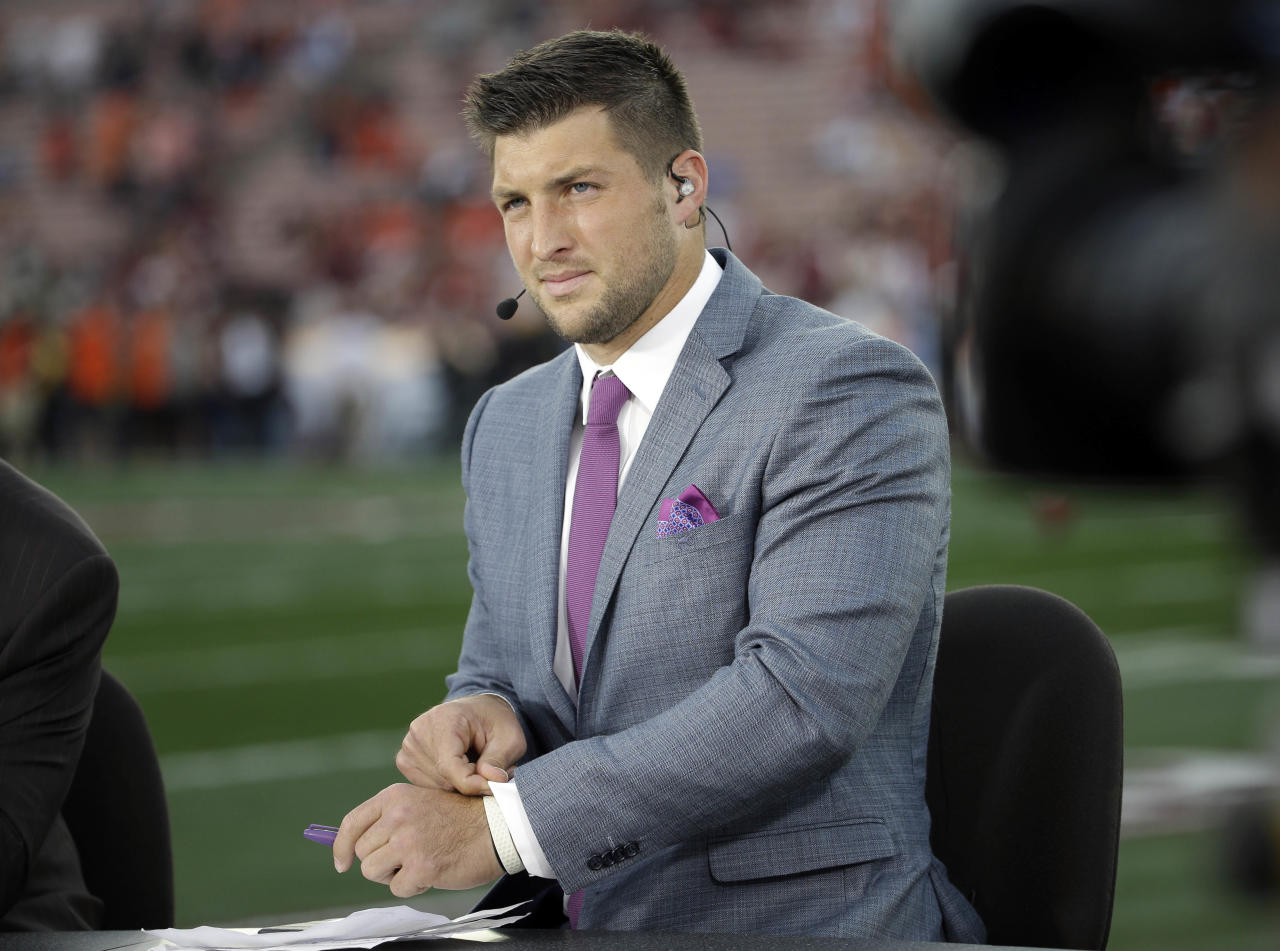 """FILE - In this Jan. 6, 2014 file, photo shows Tim Tebow on ESPN before the NCAA BCS National Championship college football game between Auburn and Florida State in Pasadena, Calif. Tebow will be a special guest on ABC's """"Good Morning America"""" on Friday, Jan. 31. (AP Photo/David J. Phillip)"""