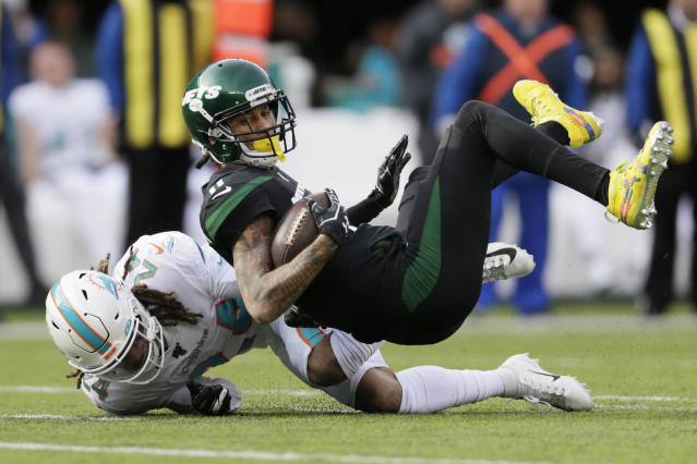 Miami Dolphins cornerback Ryan Lewis (24) tackles New York Jets wide receiver Robby Anderson (11). (AP Photo/Adam Hunger)