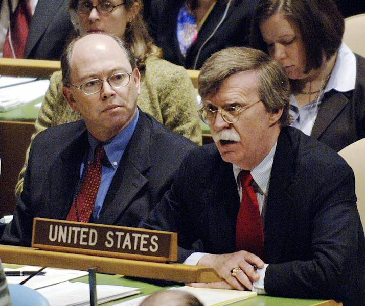 John Bolton (R) in 2006 when he was US ambassador to the United Nations where he was a fierce critic of the global body (AFP Photo/STAN HONDA)
