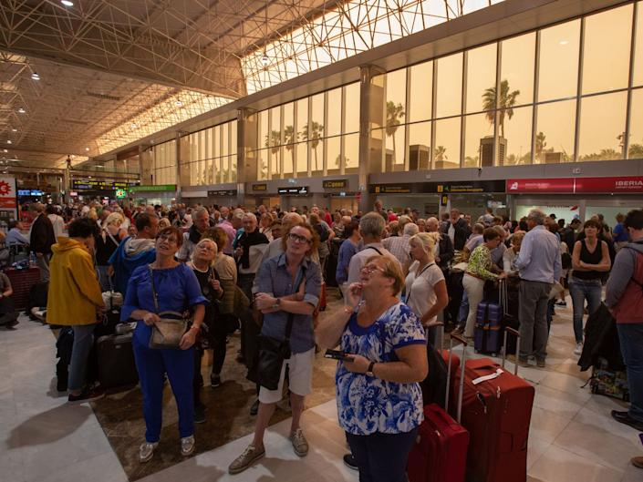 Passengers wait at Tenerife SouthReina Sofia Airport after flights were cancelled due to a sandstorm on February 23, 2020 on the Canary Island of Tenerife.