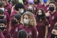 Students at Ruth K. Broad Bay Harbor K-8 Center in Bay Harbor Islands, Fla., wear face masks during a Miami Heat event, Thursday, Aug. 26, 2021. Miami-Dade schools, the nation's fourth-largest district with 340,000 students, began classes Monday with a strict mask mandate. (Joe Cavaretta/South Florida Sun-Sentinel via AP)