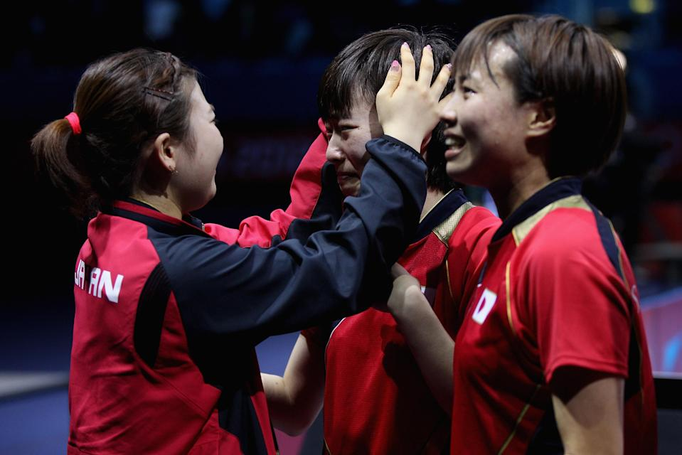 LONDON, ENGLAND - AUGUST 05: Ai Fukuhara (L), Kasumi Ishikawa (C) and Sayaka Hirano (R) of Japan celebrate after winning Women's Team Table Tennis semifinal match against team of Singapore on Day 9 of the London 2012 Olympic Games at ExCeL on August 5, 2012 in London, England. (Photo by Feng Li/Getty Images)