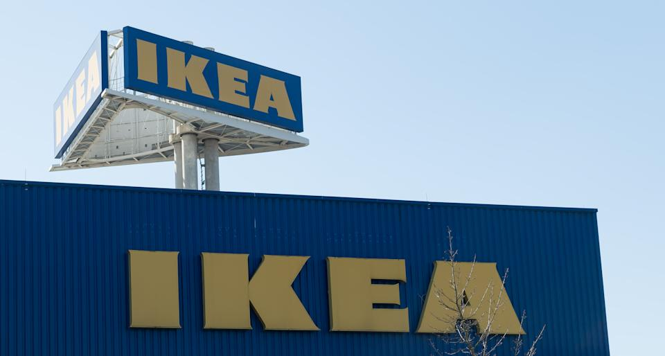 DORTMUND, GERMANY - MARCH 24: (BILD ZEITUNG OUT) The IKEA logo is seen on the pillar for outdoor advertising in the background. In the foreground is the Ikea logo on the facade of the furniture store seen on March 24, 2020 in Dortmund, Germany. (Photo by Alex Gottschalk/DeFodi Images via Getty Images)