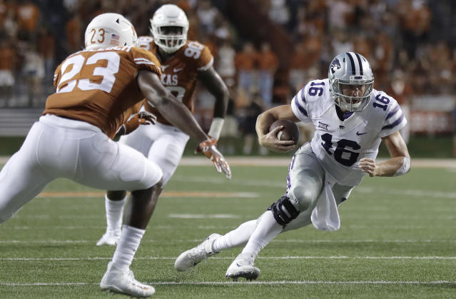 "Kansas State quarterback <a class=""link rapid-noclick-resp"" href=""/ncaaf/players/228393/"" data-ylk=""slk:Jesse Ertz"">Jesse Ertz</a> (16) keeps the ball as he runs past Texas linebacker Jeffrey McCulloch (23) during the first half of an NCAA college football game, Saturday, Oct. 7, 2017, in Austin, Texas. (AP Photo/Eric Gay)"
