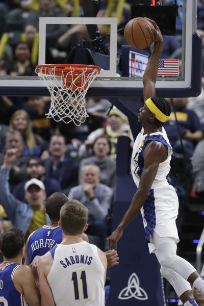 Indiana Pacers' Justin Holiday (8) dunks during the second half of an NBA basketball game against the Philadelphia 76ers, Monday, Jan. 13, 2020, in Indianapolis. Indiana won 101-95. (AP Photo/Darron Cummings)