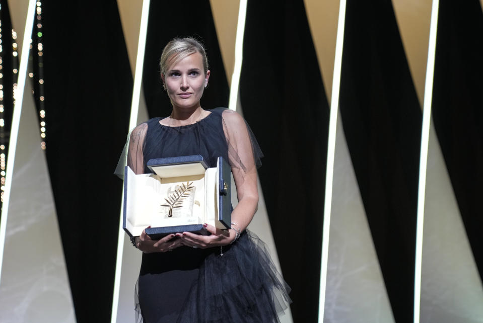 Director Julia Ducournau holds the Palme d'Or for the film 'Titane' during the awards ceremony at the 74th international film festival, Cannes, southern France, Saturday, July 17, 2021. (AP Photo/Vadim Ghirda)