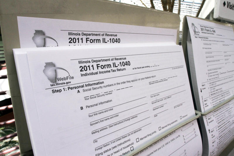 FILE - In this April 16, 2012 file photo, a 2011 1040 tax form along with other income tax forms are seen at the entrance of the Illinois Department of Revenue in Springfield, Ill. Ready or not, big changes lie ahead for virtually every U.S. taxpayer next year.  Tax cuts put into place under the Bush administration that slashed rates on wages, dividends and capital gains are set to expire at the end of 2012. The Social Security payroll tax cut enacted this year also will end, as will the exemption of millions of middle-class families from the alternative minimum tax.  (AP Photo/Seth Perlman)
