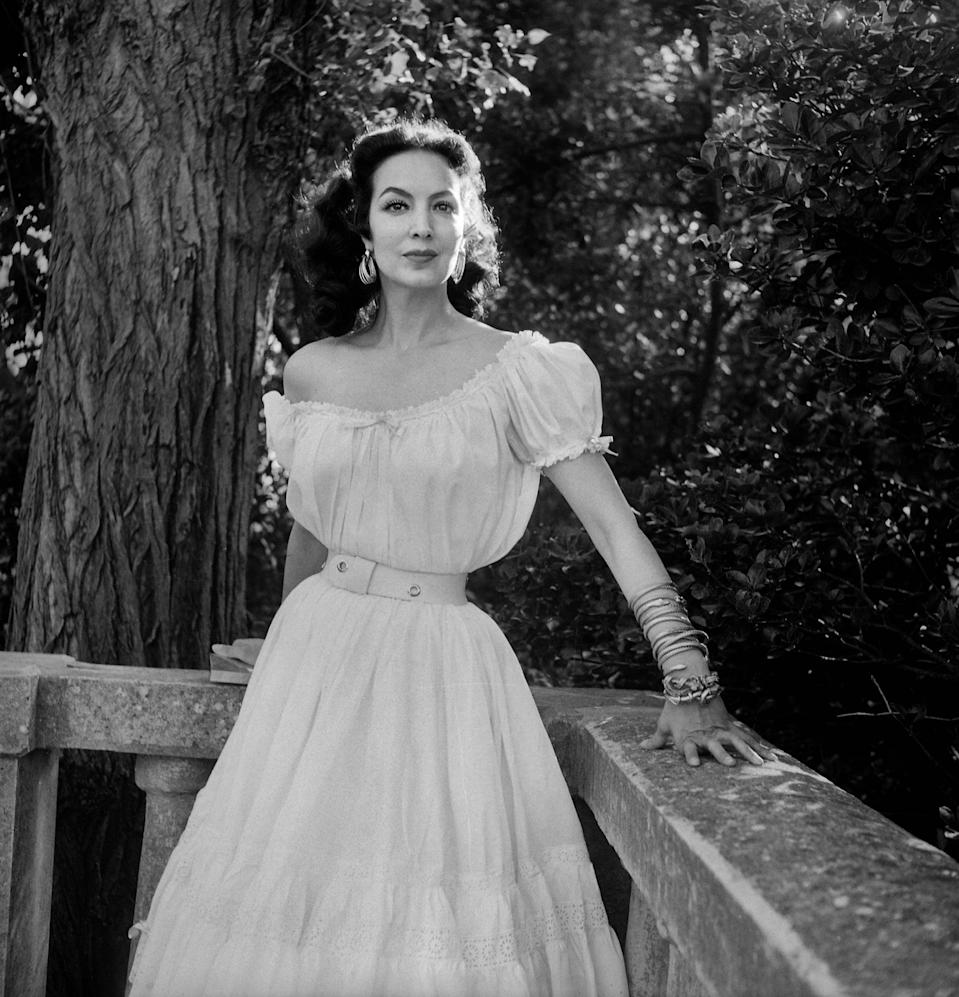 """<p>""""In Mexico, we have a really famous actress called María Félix, who was <a href=""""https://www.byrdie.com/melissa-barrera-in-the-heights-interview-5186342"""" class=""""link rapid-noclick-resp"""" rel=""""nofollow noopener"""" target=""""_blank"""" data-ylk=""""slk:an icon of the golden age of Mexican cinema"""">an icon of the golden age of Mexican cinema</a>,"""" Melissa recently told Byrdie. """"She was this badass, feminist, tough woman with arched eyebrows. And she had a beauty mark on her cheek. And she was gorgeous and had a deep voice. Everyone wanted to be her. She's an icon that I love.""""</p>"""