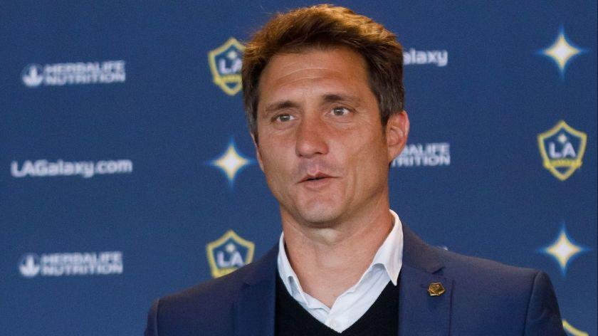 Mandatory Credit: Photo by EUGENE GARCIA/EPA-EFE/REX (10047396a) New Los Angeles Galaxy soccer head coach Guillermo Barros Schelotto holds up a team jersey during a press conference at the Dignity Health Sports Park in Carson, California, USA, 03 January 2019. Schelotto is a former Argentine national team player and manager of Argentine club teams. Argentine Guillermo Barros Schelotto named LA Galaxy head coach, Carson, USA - 03 Jan 2019 ** Usable by LA, CT and MoD ONLY **