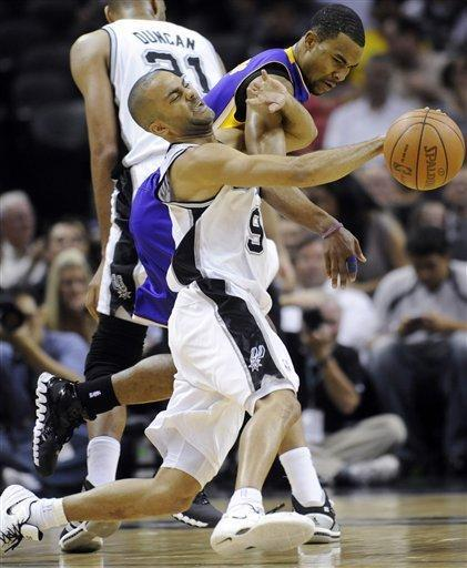 San Antonio Spurs guard Tony Parker, foreground, of France, is fouled by Los Angeles Lakers guard Ramon Sessions during the first half of an NBA basketball game on Friday, April 20, 2012, in San Antonio. (AP Photo/Bahram Mark Sobhani)