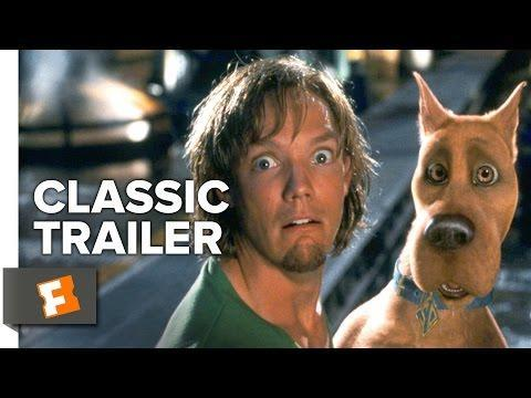 """<p>Scooby and his gang undoubtedly made some enemies over the years. So when they're mysteriously brought in to investigate a series of paranormal incidents at the spring break hot spot Spooky Island, it looks like their past might be coming back to bite them. Deceptively written by <em>Guardians of the Galaxy </em>director James Gunn!</p><p><a class=""""link rapid-noclick-resp"""" href=""""https://www.amazon.com/Scooby-Doo-Movie-Jr-Freddie-Prinze/dp/B003EY62II?tag=syn-yahoo-20&ascsubtag=%5Bartid%7C2139.g.36827219%5Bsrc%7Cyahoo-us"""" rel=""""nofollow noopener"""" target=""""_blank"""" data-ylk=""""slk:Stream It Here"""">Stream It Here</a></p><p><a href=""""https://www.youtube.com/watch?v=o3dbeI0BU1k&ab_channel=MovieclipsClassicTrailers"""" rel=""""nofollow noopener"""" target=""""_blank"""" data-ylk=""""slk:See the original post on Youtube"""" class=""""link rapid-noclick-resp"""">See the original post on Youtube</a></p>"""