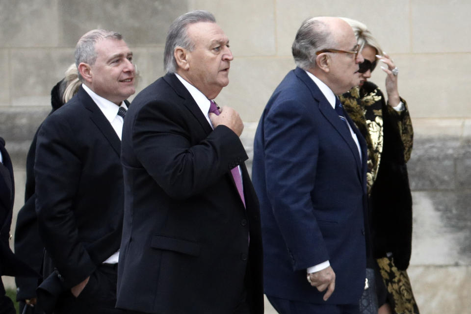 FILE - In this Dec. 5, 2018, file photo, Rudy Giuliani, foreground right, and others, including Lev Parnas, left, arrive for the state funeral for former President George H.W. Bush at the National Cathedral in Washington. Federal prosecutors are investigating former New York City mayor Rudy Giuliani, as part of a criminal case brought against his former associates, Lev Parnas and Igor Fruman, Soviet-born business partners from Florida who played key roles in Giuliani's efforts to launch the Ukrainian corruption investigation against the Bidens. (AP Photo/Patrick Semansky, File)