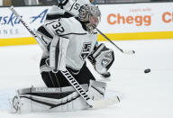 Los Angeles Kings goaltender Jonathan Quick blocks a shot by the San Jose Sharks during the third period of an NHL hockey game Saturday, April 10, 2021, in San Jose, Calif. Los Angeles won 4-2. (AP Photo/Tony Avelar)