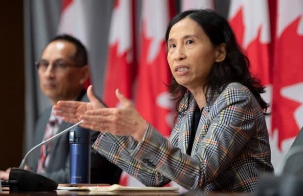 Deputy Chief Public Health Officer Howard Njoo looks on as Chief Public Health Officer Theresa Tam responds to a question during a news conference on Friday, September 11, 2020 in Ottawa.