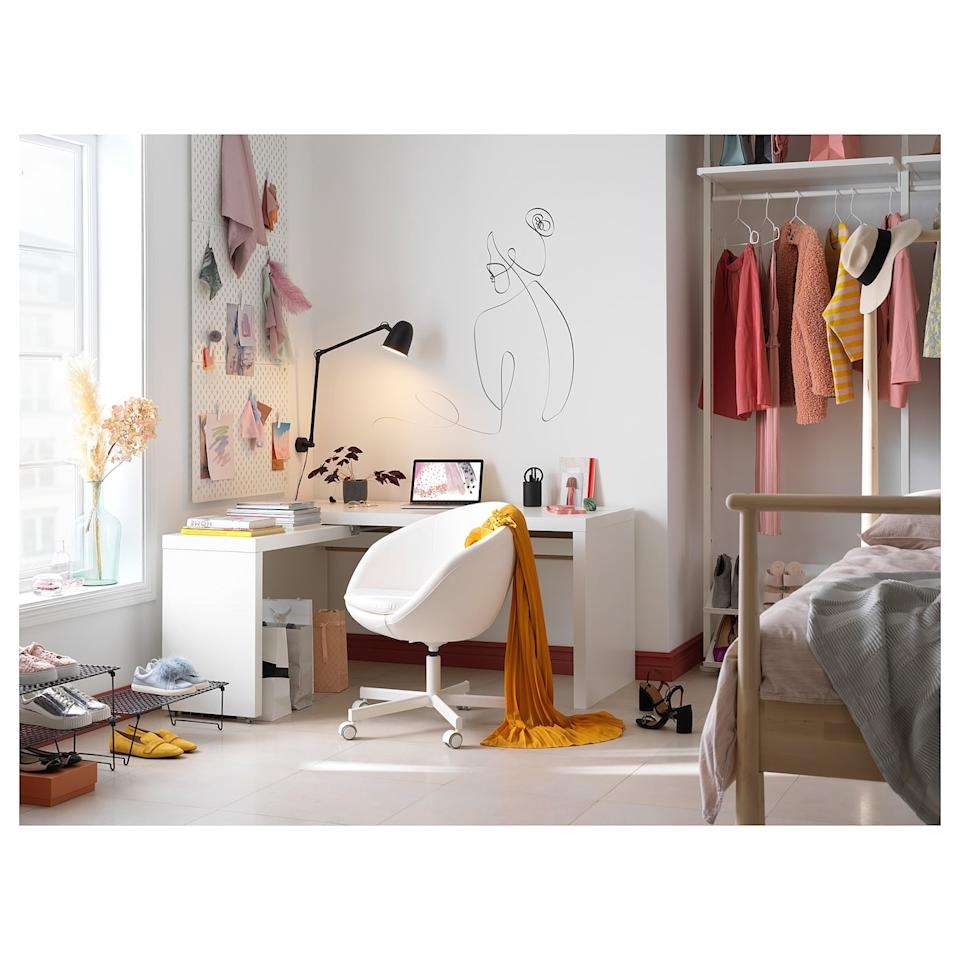 "<p>The <product href=""https://www.ikea.com/us/en/p/malm-desk-with-pull-out-panel-white-70214192/"" target=""_blank"" class=""ga-track"" data-ga-category=""Related"" data-ga-label=""https://www.ikea.com/us/en/p/malm-desk-with-pull-out-panel-white-70214192/"" data-ga-action=""In-Line Links"">Malm Desk With Pull-Out Panel</product> ($179) has a pull-out surface to give your workspace more room.</p>"