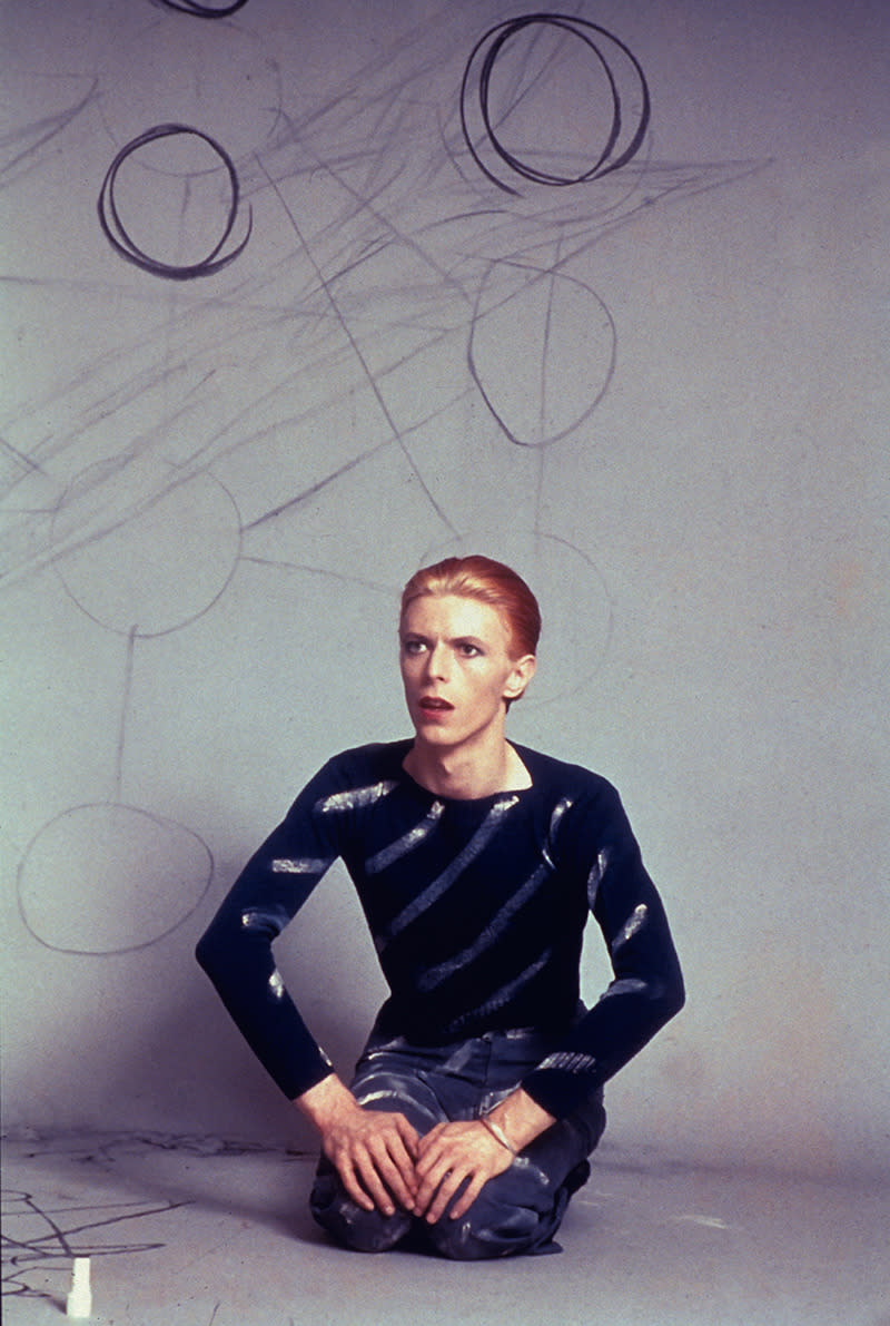 """""""David seated drawing circles on the background paper and then the Kabbalah Tree of Life diagram on the floor. Los Angeles, 1974."""""""