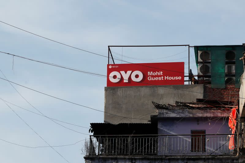 FILE PHOTO: The logo of OYO, India's largest and fastest-growing hotel chain, is seen installed on a hotel building in New Delhi