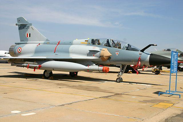 In the wee hours of February 26, 12 Mirage 2000 fighter aircraft of the Indian Air Force crossed the border into the disputed area of Kashmir to conduct a surgical strike on Jaish-e-Mohammed terrorists camps in the Balakot region in Pakistan. Codenamed Operation Bandar, the pilots dropped five Spice 2000 bombs during the strike. As per media reports, around 200-350 terrorists were killed in the attack, however, Pakistan maintains that the attack did not cause any casualties. Tensions between the two nuclear powered nations escalated post the strikes, with Pakistan vowing to respond to the air attack. Border skirmishes between the two countries have continued, since. <em><strong>Image credit</strong></em>: For representation only. By aeroprints.com, CC BY-SA 3.0, https://commons.wikimedia.org/w/index.php?curid=32538737