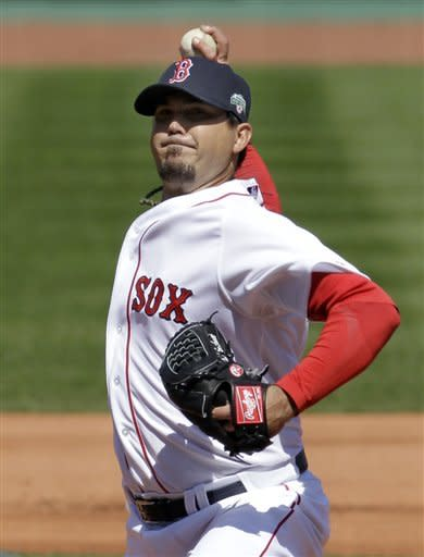 Boston Red Sox starting pitcher Josh Beckett fires a pitch to the Tampa Bay Rays during the first inning of a baseball game at Fenway Park in Boston, Friday, April 13, 2012. (AP Photo/Elise Amendola)