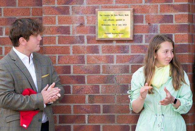 Benjie, left, and Georgia Ingram-Moore unveil a plaque at the Army Foundation College