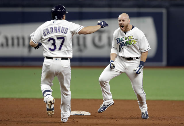 Tampa Bay Rays' Michael Brosseau, right, celebrates his walkoff single off Detroit Tigers relief pitcher Matt Hall with Travis d'Arnaud (37) during the 13th inning of a baseball game Saturday, Aug. 17, 2019, in St. Petersburg, Fla. (AP Photo/Chris O'Meara)