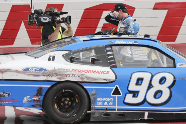 Chase Briscoe wipes away tears after winning the NASCAR Xfinity series auto race Thursday, May 21, 2020, in Darlington, S.C. (AP Photo/Brynn Anderson)