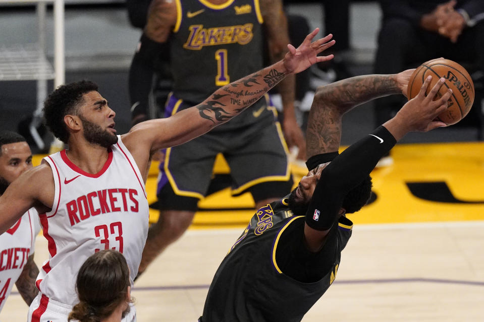 Los Angeles Lakers center Andre Drummond, right, grabs a rebound away from Houston Rockets forward Anthony Lamb during the first half of an NBA basketball game Wednesday, May 12, 2021, in Los Angeles. (AP Photo/Mark J. Terrill)