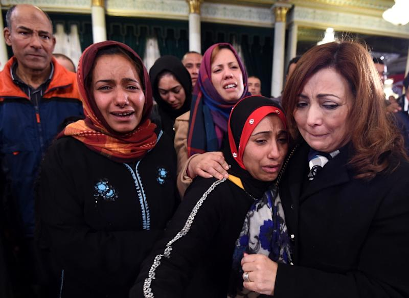 Nobel Peace Prize winner Ouided Bouchamaoui (R), who is president of the Tunisian Employers' Association, consoles relatives of the presidential guards killed November 24 in a suicide bombing at a ceremony honoring them on November 25 2015 (AFP Photo/Fethi Belaid)