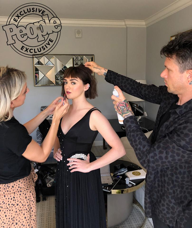 """<strong>The Pro:</strong> Hairstylist Ryan Richman (far right)  <strong>The Look:</strong> """"We wanted to take Maisie in a more mature direction as she is exploring new roles now that <em>Game of Thrones</em> has come to an end. The first step was changing her hair color from pink to a natural brunette,"""" says the pro.  <strong>The Key Products:</strong> """"To protect Maisie's new brunette color we shampooed and conditioned her hair with <a href=""""https://protect-us.mimecast.com/s/zUxaCXDPDpIXlP3PQt9TRE1?domain=target.com"""">Dove Color Care Shampoo</a>and<a href=""""https://protect-us.mimecast.com/s/1_S8CYEZEqTLKWPW7c3XG7F?domain=target.com"""">Dove Color Protect Conditioner</a>. The sulfate-free products are gentle and help to keep the color vibrant while making the hair silky and manageable. To create an undone texture I used a 1"""" flat iron and bent the hair in an """"S"""" pattern starting from root to ends. After I waved each section I sprayed the waves with<a href=""""https://protect-us.mimecast.com/s/JFMRC1wMw3FMrAKA4TmA1Kv?domain=target.com"""">Dove Style+Care Compressed Micro Mist Flexible Hold Hairspray</a>to secure the texture."""""""
