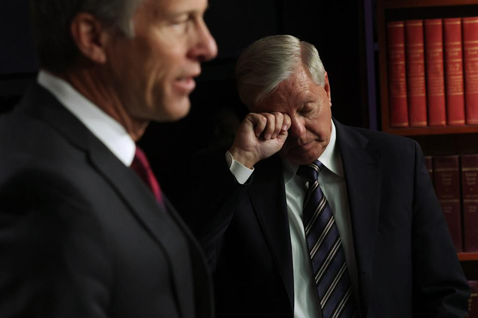 Minority Whip Sen. John Thune, R-S.D., speaks as Sen. Lindsey Graham, R-S.C., listens during a news conference at the U.S. Capitol on March 5, 2021 in Washington.