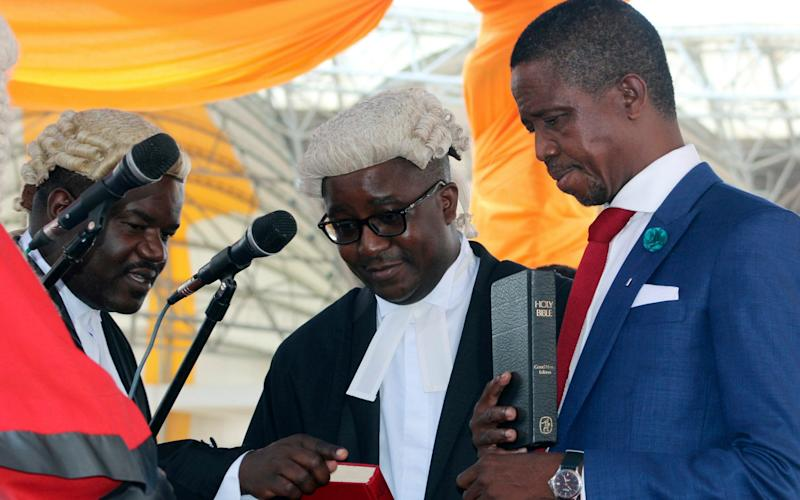 Edgar Lungu, right, is sworn in as president at an inauguration ceremony in Lusaka in 2015 - Credit: Moses Mwape/AP