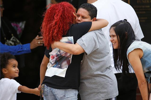 <p>People hug as they arrive for the funeral of Peter Gonzalez-Cruz and Gilberto Ramon Silva Menendez, both victims of the shooting at Pulse night club in Orlando on June 17, 2016. (Reuters/Carlo Allegri) </p>