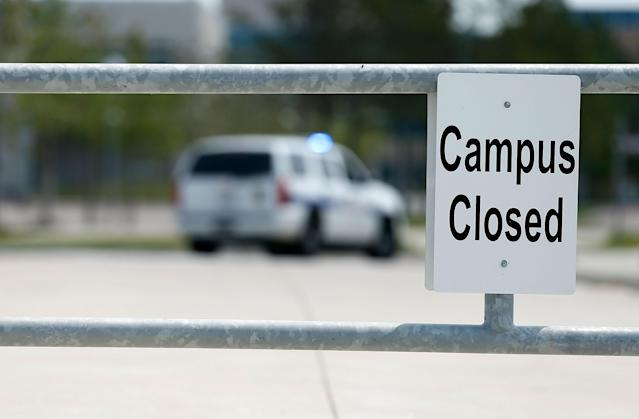 "CYPRESS, TX - APRIL 09: A sign says ""Campus Closed"" as police seal off the area after at least 14 people were injured in a stabbing incident at the Cy-Fair campus of Lone Star College on April 9, 2013 in Cypress, Texas. The community college located in northwest Houston was on lockdown until police detained a 21-year-old male student believed to be a suspect. (Photo by Scott Halleran/Getty Images)"
