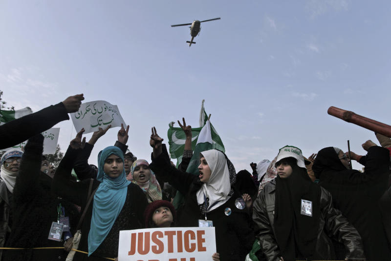 Supporters of Pakistani Sunni Muslim cleric Tahir-ul-Qadri, chant anti-government slogans during a rally in Islamabad, Pakistan, Tuesday, Jan. 15, 2013. Thousands of anti-government protesters are rallying in the streets of the Pakistani capital for a second day despite early-morning clashes with police who fired off shots and tear gas to disperse the crowd. (AP Photo/Muhammed Muheisen)
