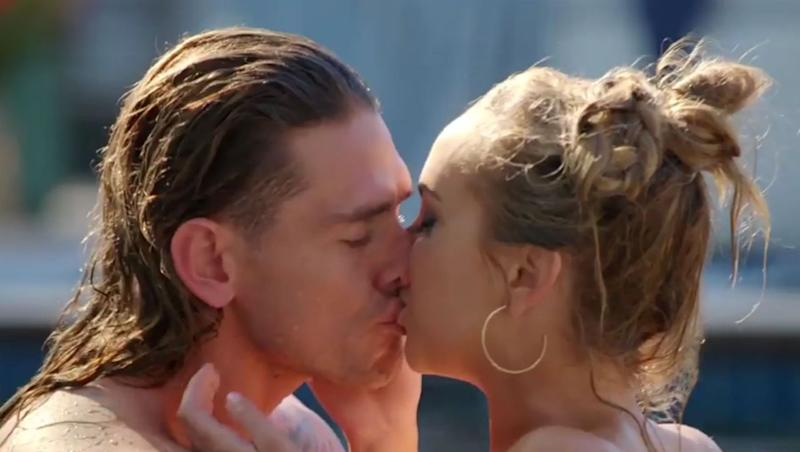 Angie Kent and Timm Hanly share a kiss in a pool on The Bachelorette in 2019