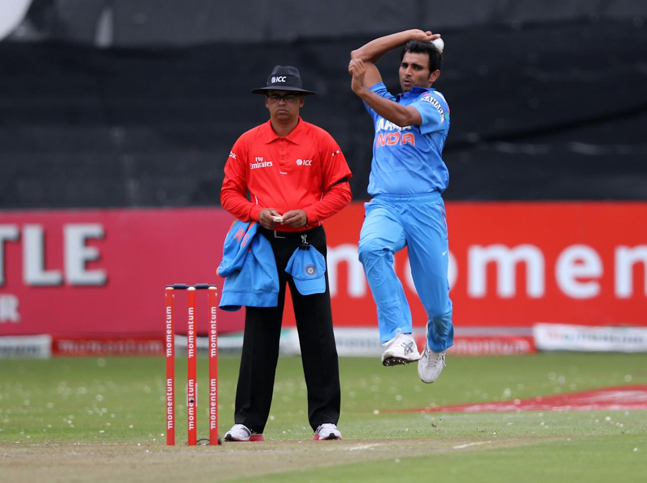 India's cricketer Mohammed Shami bowls during the One day International (ODI) Cricket match between India and South Africa at SAHARA Stadium Kingsmead in Durban on December 8, 2013. AFP PHOTO / STRINGER
