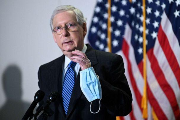 PHOTO: Senate Majority Leader Mitch McConnell holds a face mask while participating in a news conference at the U.S. Capitol in Washington, Oct. 20, 2020. (Erin Scott/Reuters)