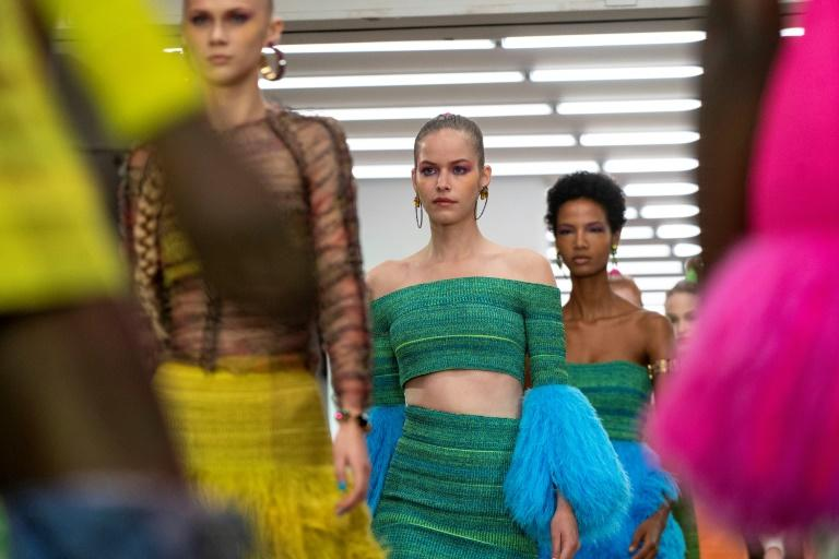 First up to present his handiwork on Friday was knitwear ace Mark Fast, with some green, pink and neon yellow creations inspired by the colours of the Amazon rainforest (AFP Photo/Niklas HALLE'N)