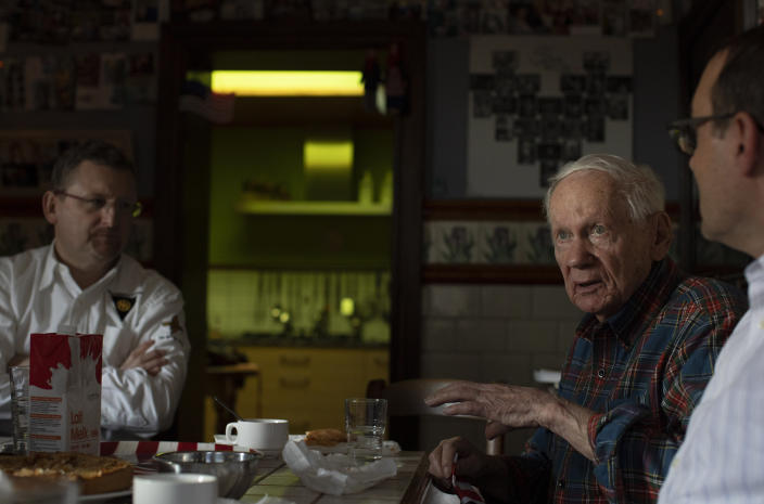 In this photo taken on Tuesday, Dec. 10, 2019, U.S. Battle of the Bulge veteran Arthur Jacobson second right, speaks during a lunch in the dining room of the Remember Museum 39-45 in Thimister-Clermont, Belgium. In the bucolic, verdant hills which were once among the worst killing grounds of WWII Marcel and Mathilde Schmetz have shared coffee and cake with countless veterans, telling stories that span generations. Veterans of the WWII Battle of the Bulge are heading back to mark, perhaps the greatest battle in U.S. military history, when 75-years ago Hitler launched a desperate attack, deep through the front lines in Belgium and Luxembourg to be thwarted by U.S. military. (AP Photo/Virginia Mayo)